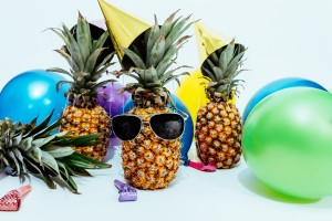 3 pineapples surrounded by party elements to indicate celebrating the three webinars